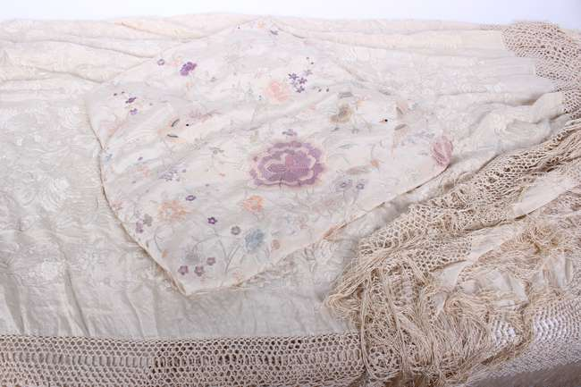 A late 19th/early 20th Century embroidered ivory coloured fringed Chinese silk shawl