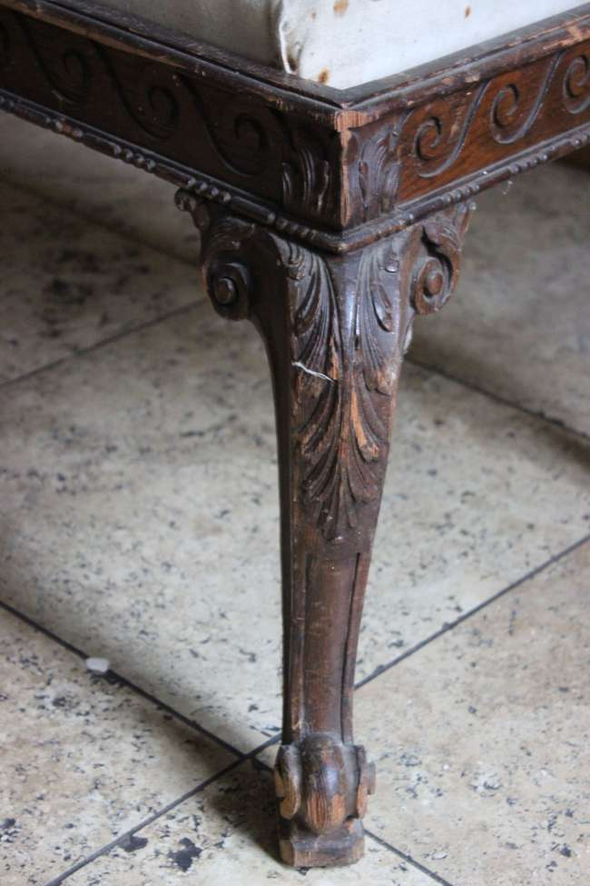 A 17th Century style long footstool with carved trailing frieze on cabriole legs