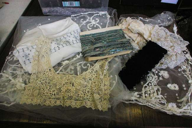A collection of early and mid 20th Century lace and trimmings; a length of pale blue sequin trimming