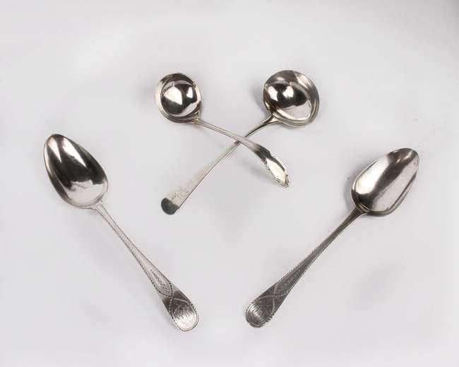 A pair of bright cut Georgian sterling silver soup spoons together with a Georgian silver ladle and one other ladle. 6.7ozt.