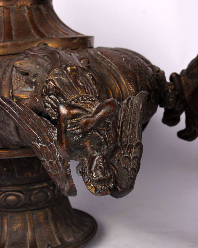 Three copper early 20th century ceiling lights. A pair band one similar  with stylised angel supports. Originally from a large Cardiff hotel. 44cm(h) 57cm(h)