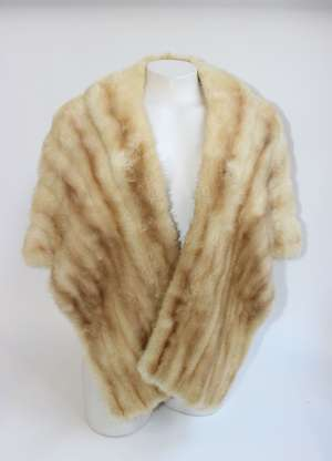 A 1950s pale mink cross-over style evening stole