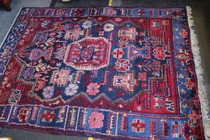 A Middle Eastern rug and another blue ground example
