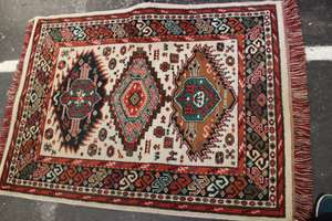 An Afghan rug and three further Middle Eastern examples