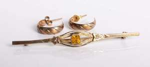 A 9ct citrine set bar brooch with a pair of 9ct bi coloured gold hoop earrings