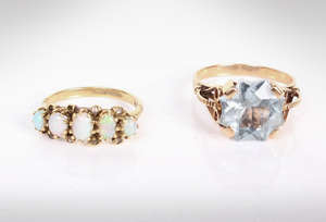 A 14k gold and aquamarine dress ring together with 9ct five stone diamond ring with rose cut diamond accents. 7.9g