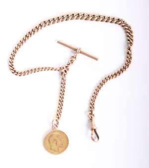 A 9ct gold curb link albert chain with half sovereign fob. 35.6g