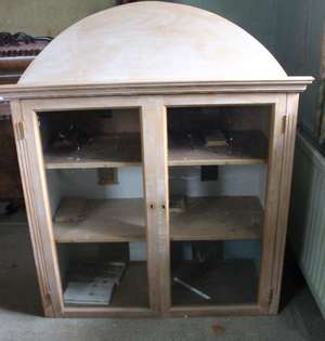 A pine glazed mirror back hanging cupboard with arched pediment, a further cupboard and Venetian style mirror