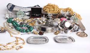 A collection of costume jewellery and an alligator skin handbag