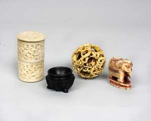 A collection of Ivory items to include an intricately carved four piece puzzle ball