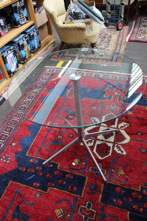 A glass topped table 'Kruze'
