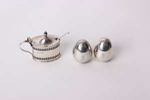 A pair of sterling silver egg shaped pepperettes by William Hutton & Sons