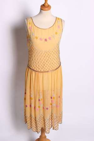 A 1920s sleeveless yellow silk cocktail dress