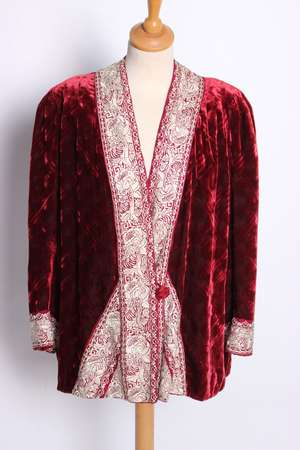 An early 20th Century red silk velvet evening jacket edged with  a border of silver silk Chinese embroidery by John Field and Son of Sidmouth. A dark magenta full length empire line velvet dress with short gathered sleeves and a small cape to match (