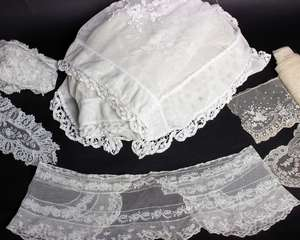 A large white lace panel with appliqué decoration; a length of lace edging (approximately 4 metres) a Honiton lace collar