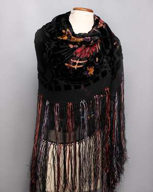 An early 20th Century black silk devoré fringed shawl