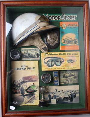 A collection of early motor racing/Grand Prix memorabilia in a glazed display frame to include a British Grand Prix programme dated 1949