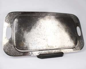 An Indian white metal tray with cast and planished decoration and pierced loop handles. 60cm x 31cm 48ozt
