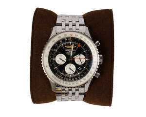 A Breitling Navitimer with silver clasp bracelet, serial number 4020938, including leather presentation box, gift box, warranty card and documentation.